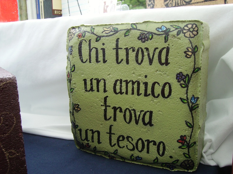 """Italian for : """"He who finds a friend finds a treasure."""""""